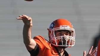 Dan Conte #8, Carey quarterback, throws a pass