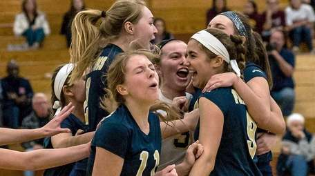 Bayport-Blue Point celebrates their win against Seaford in