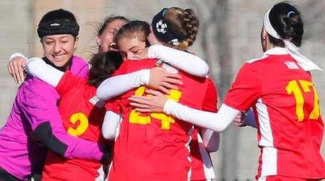 Sacred Heart Academy celebrates their 1-0 victory over