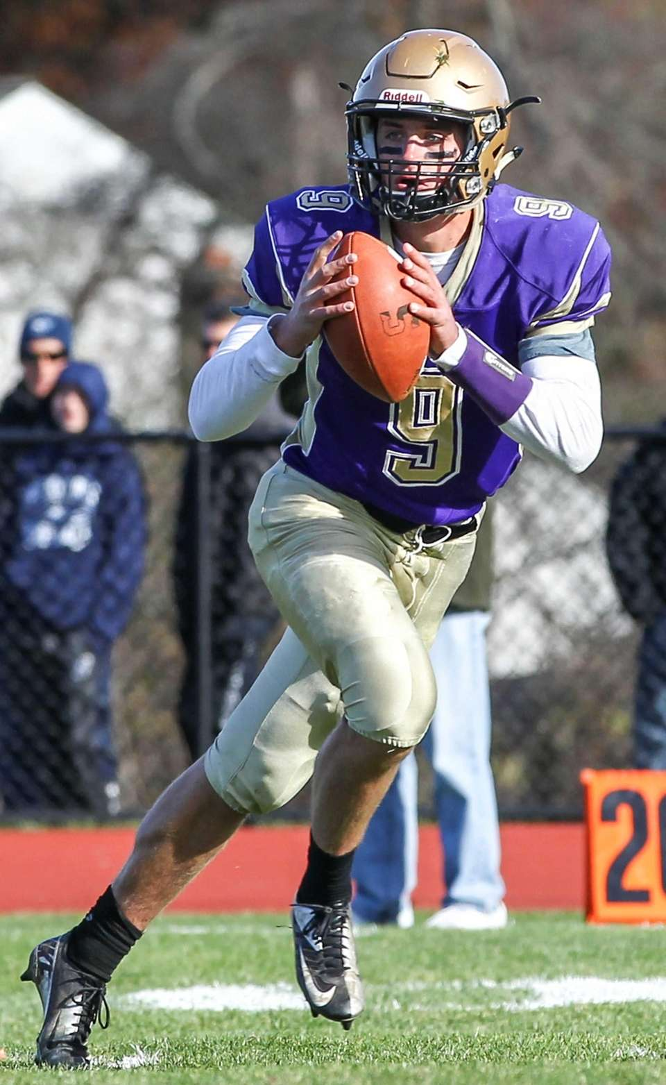 Jack Coan of Sayville fades back to pass