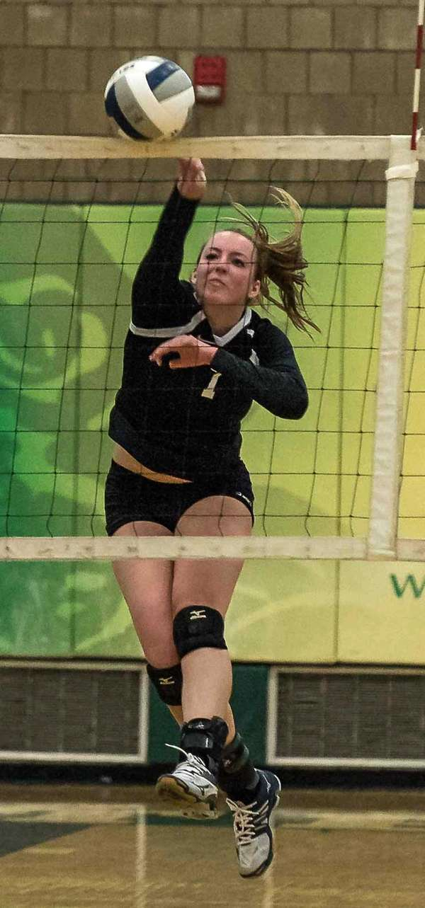Kings Park's Lauren Kloos spikes the ball during