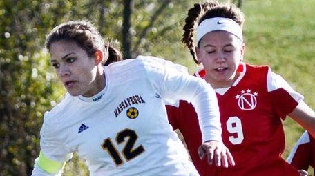 Massapequa's Julia Ophals, left, keeps the ball from