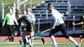 Ward Melville's Kate Mulham (4) moves the ball