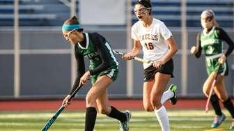 Carle Place's Gianna McKeough (4) moves the ball