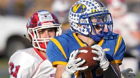 West Islip's Dylan Carrino (22) grabs a pass