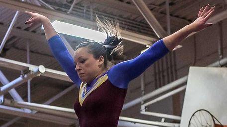 Bayshore's Skye Harper performs her balance beam routine