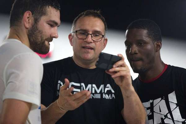 Trainer Mark Henry, center, shows former UFC middleweight