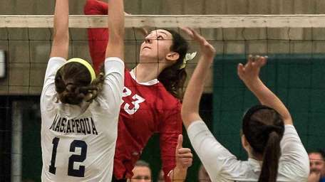 Connetquot's Cassandra Patsos (23) spikes the ball during