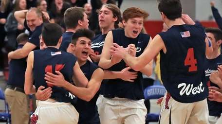 SmithtownWest's players celebrate their four-set victory over Plainview