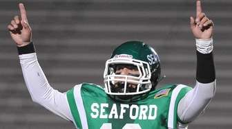 Andrew Cain #12, Seaford quarterback, reacts after his