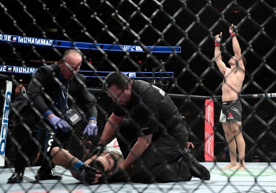 Vicente Luque, right, celebrates after knocking out Belal