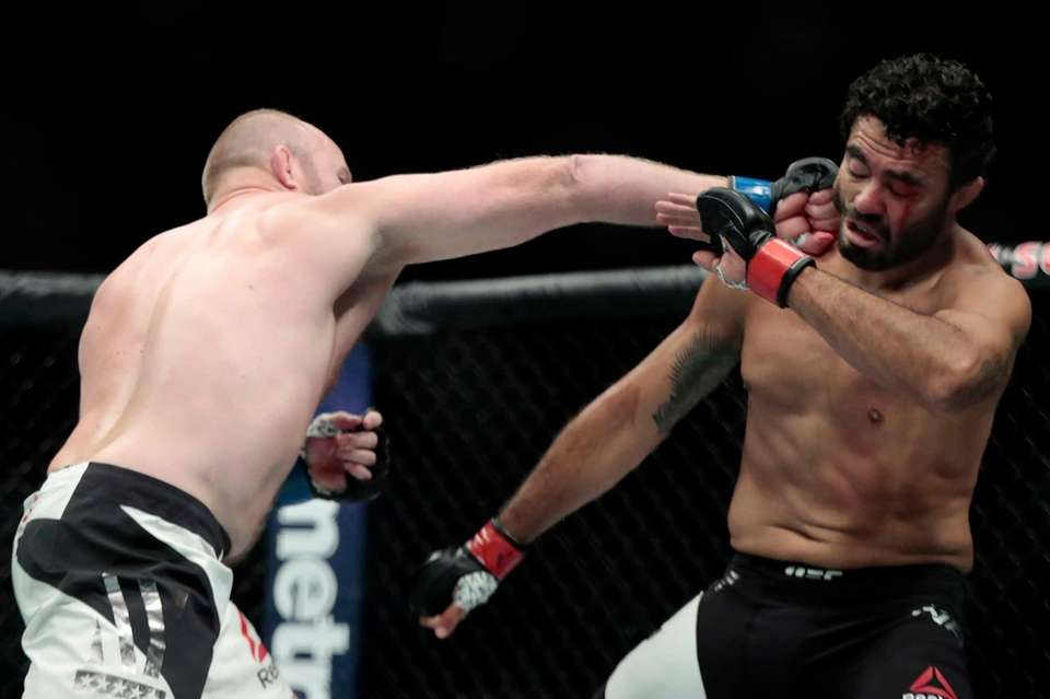 Tim Boetsch, left, connects a punch on Rafael