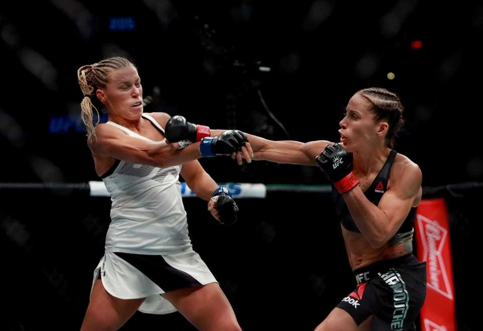 Liz Carmouche of the United States lands a