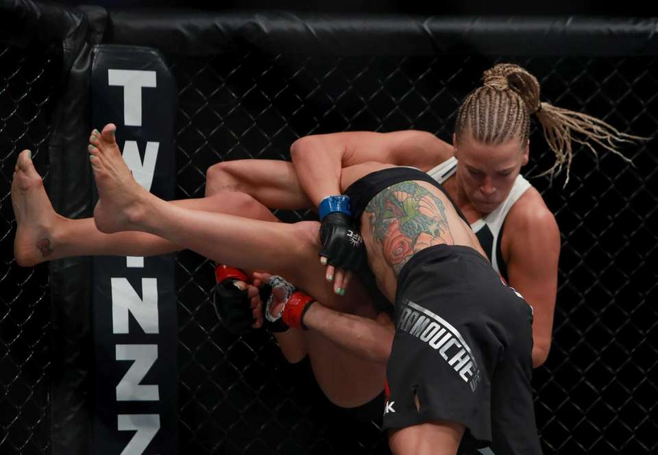Liz Carmouche of the United States fights against