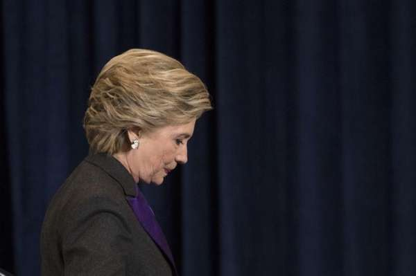 Democratic presidential candidate Hillary Clinton walks off the