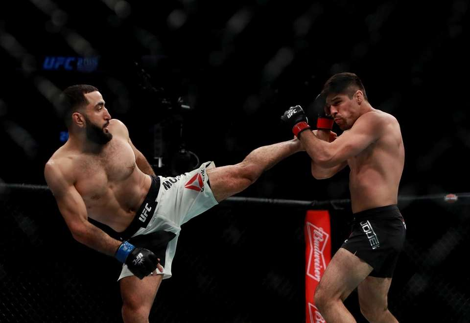 Belal Muhammad, left, of the United States fights