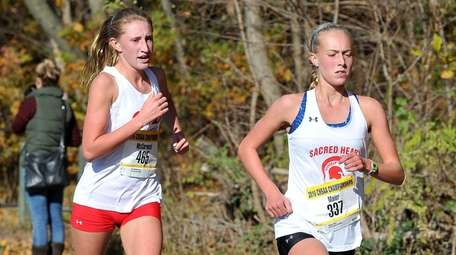 Maggie Maier of Sacred Heart runs during the