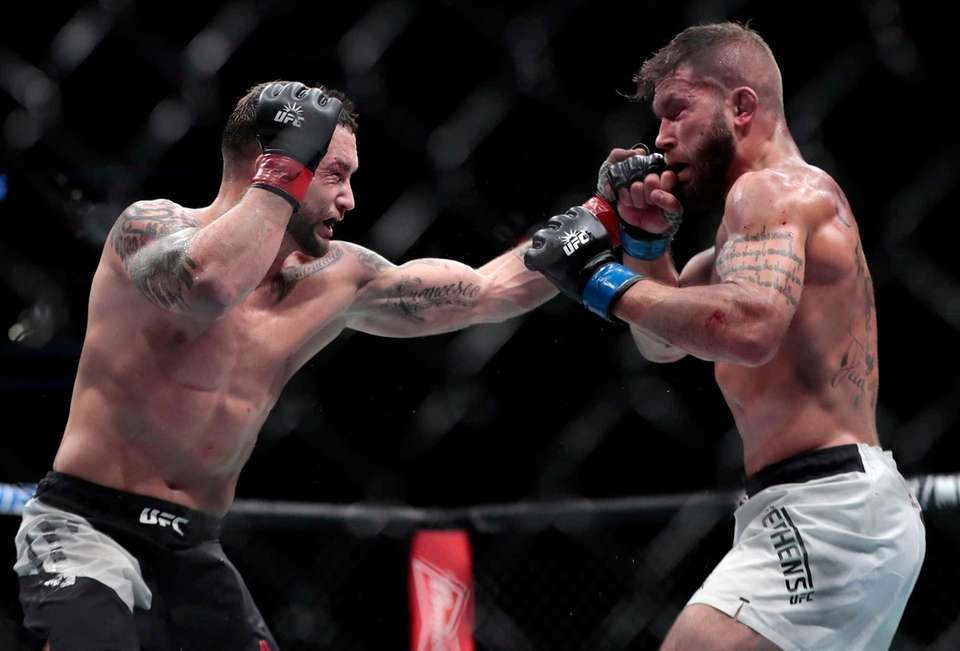 Frankie Edgar, left, throws a punch at Jeremy