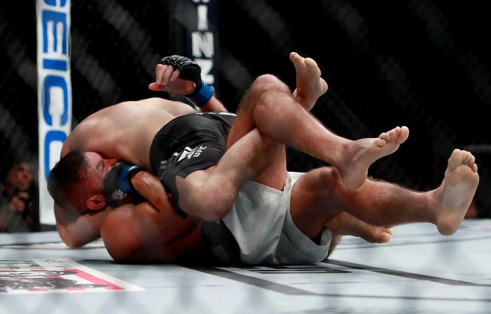 Jeremy Stephens of the United States (bottom) fights