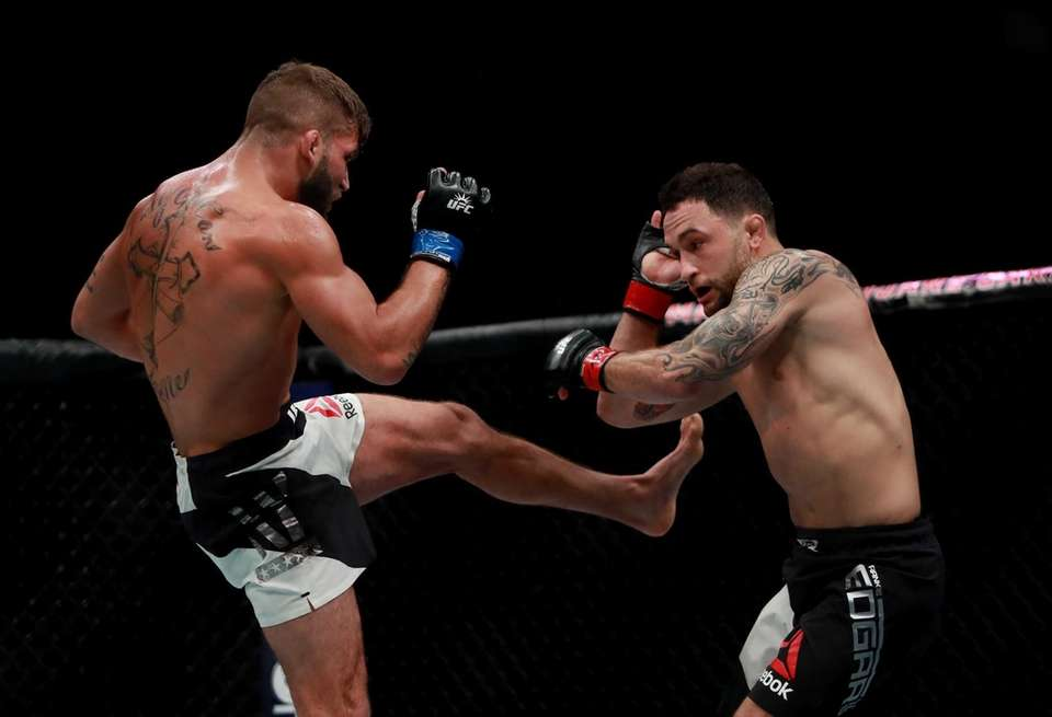 Jeremy Stephens of the United States (left) fights