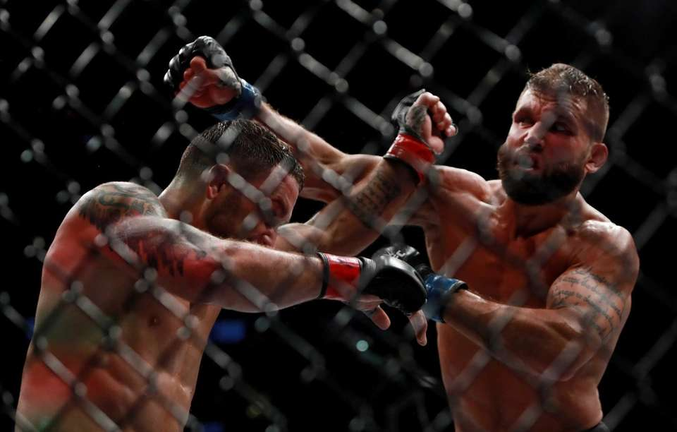 Jeremy Stephens of the United States (right) fights