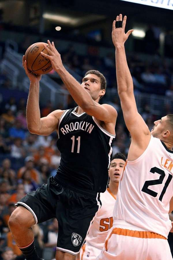 Nets center Brook Lopez goes to the basket