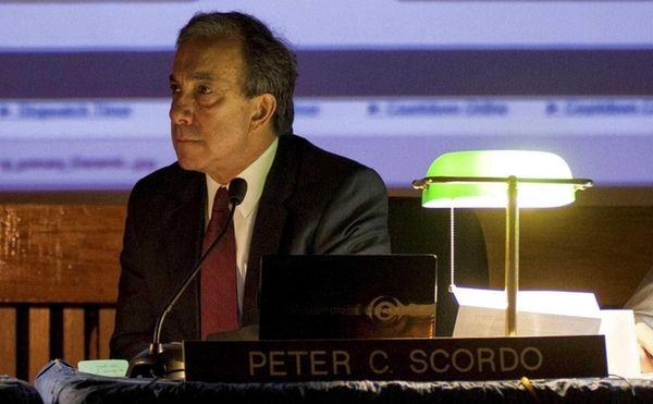 Peter C. Scordo, who retired in June from