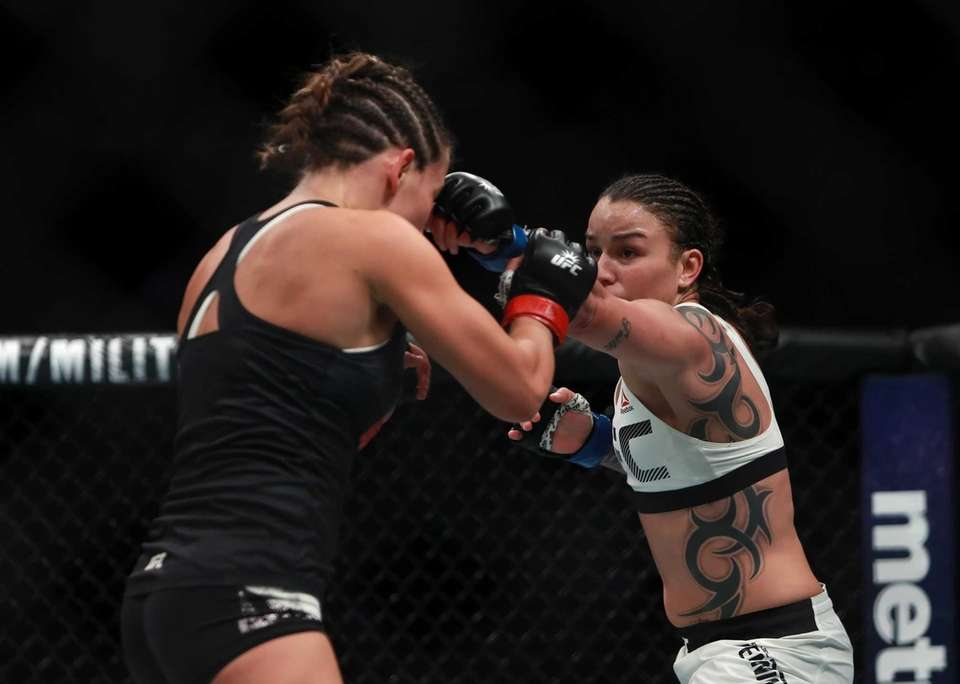 Miesha Tate of the United States (left) fights