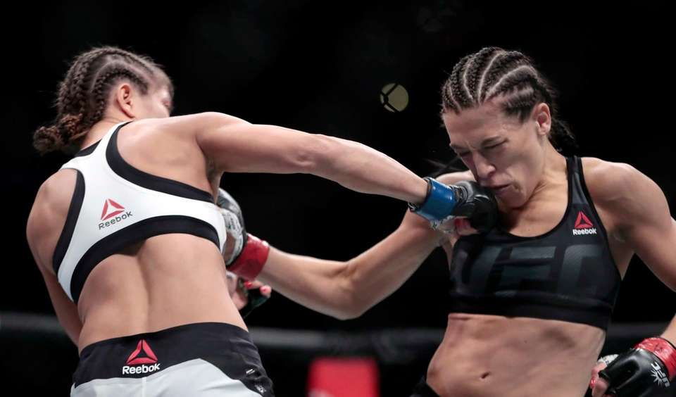 Karolina Kowalkiewicz, left, lands a shot on Joanna