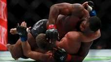 Tyron Woodley of the United States (bottom) fights