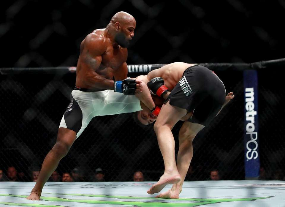 Yoel Romero of Cuba (left) fights against Chris