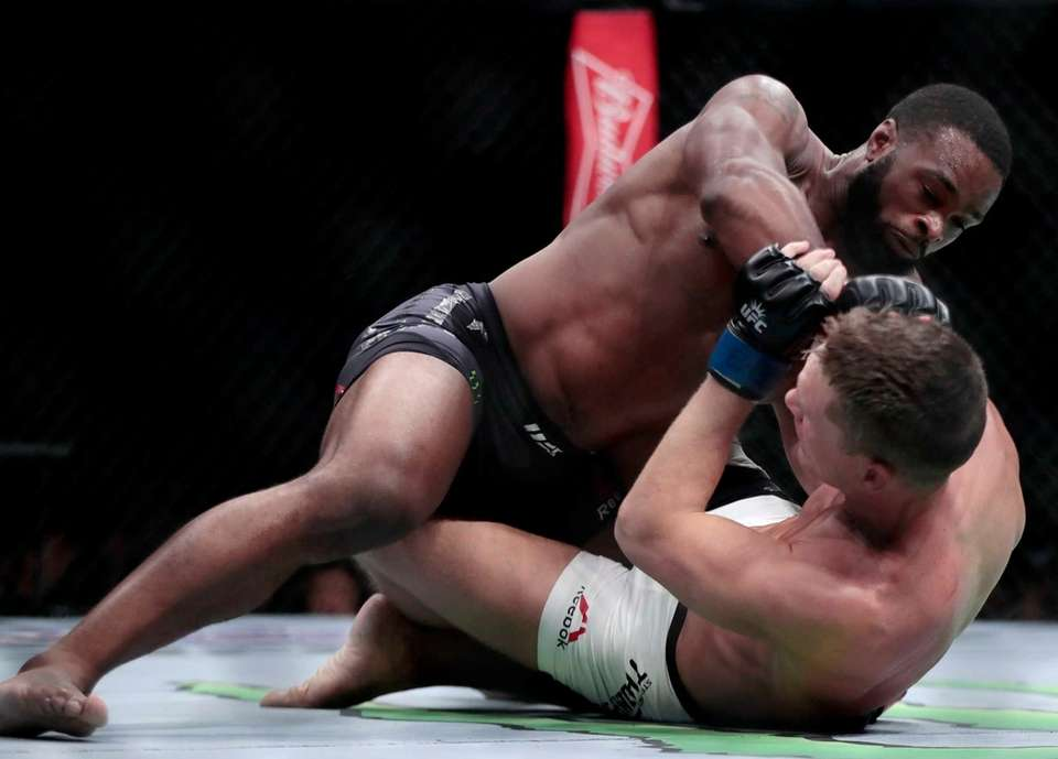 Tyron Woodley, top, fights Stephen Thompson during a