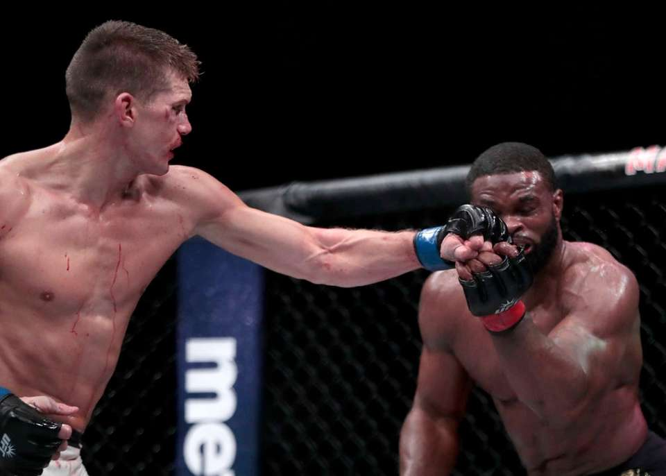 Stephen Thompson, left, connects with Tyron Woodley during