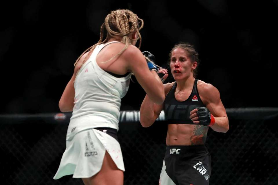 Liz Carmouche of the United States (right) fights