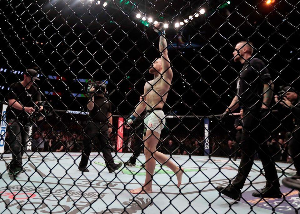 Conor McGregor enters the octagon before fighting Eddie