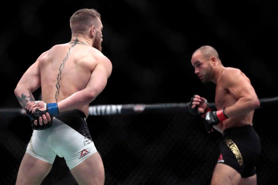 Conor McGregor, left, taunts Eddie Alvarez during a
