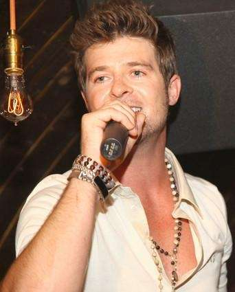 Singer Robin Thicke performs at the celebration for