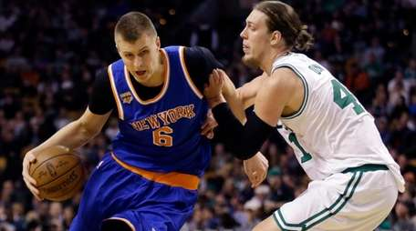 New York Knicks forward Kristaps Porzingis drives against