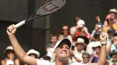 Melanie Oudin reacts at match point while playing
