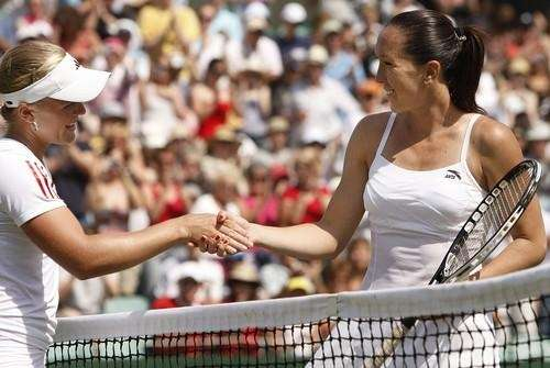 Melanie Oudin, left, greets Jelena Jankovic of Serbia
