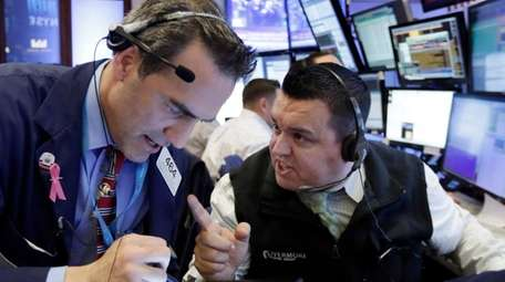 Traders Gregory Rowe, left, and Robert Finnerty on