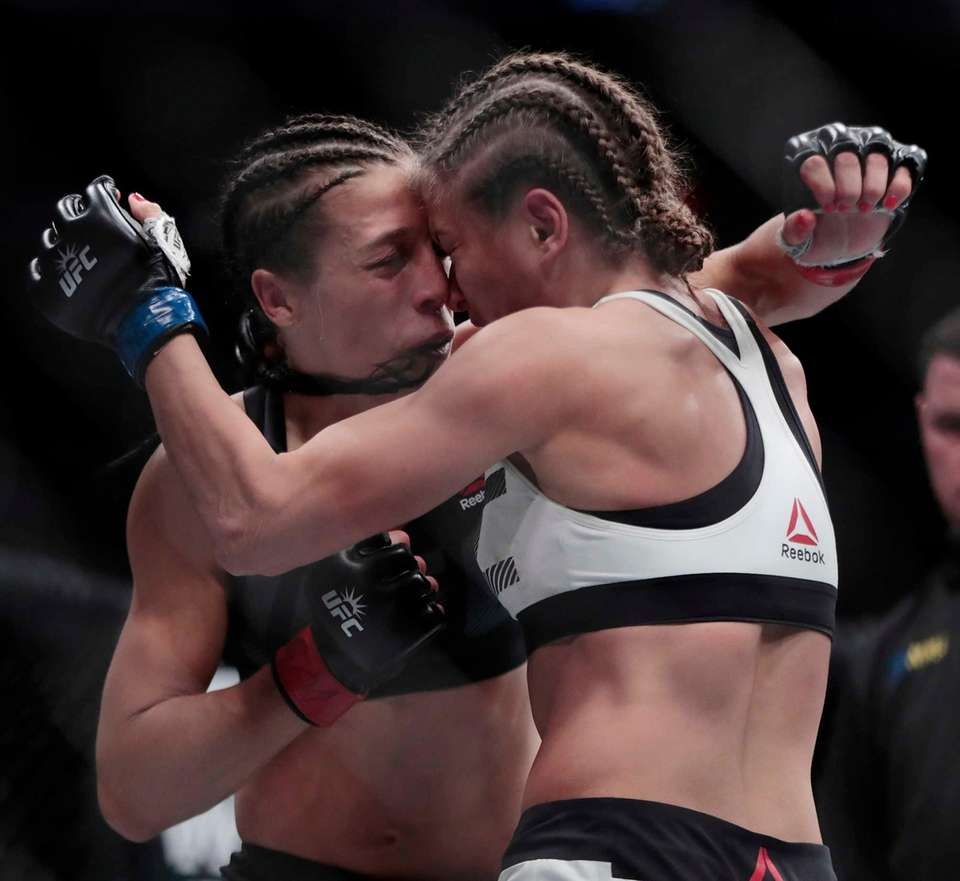 Karolina Kowalkiewicz, right, and Joanna Jedrzejczyk work in