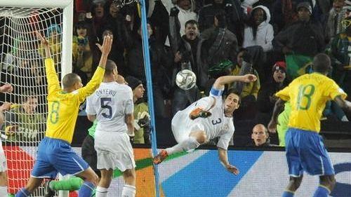 US defender Carlos Bocanegra (3) shoots at the