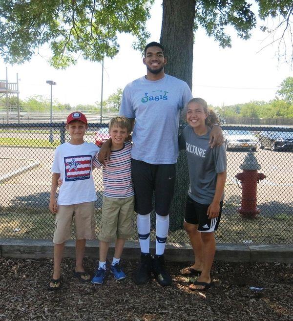 Minnesota Timberwolves basketball star Karl-Anthony Towns with Kidsday