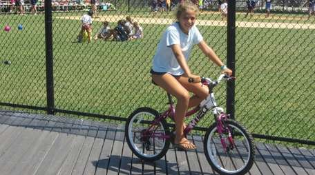 Kidsday reporter Kendall Messler tests the Kent bike.