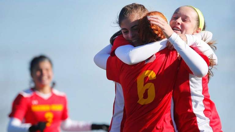 Sacred Heart Academy players celebrate the first goal