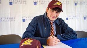 Portledge School boys basketball player Jordan Salzman signs