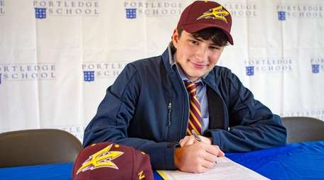 Portledge School boys basketball player Jordan Salzman signs