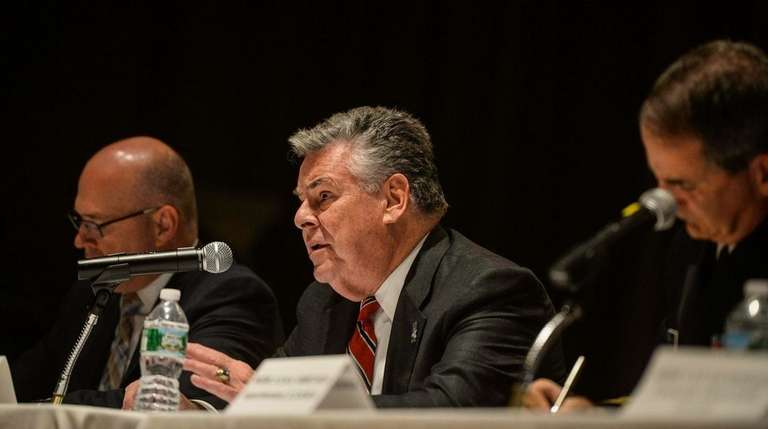 United States Congressman Peter King speaks amongst the