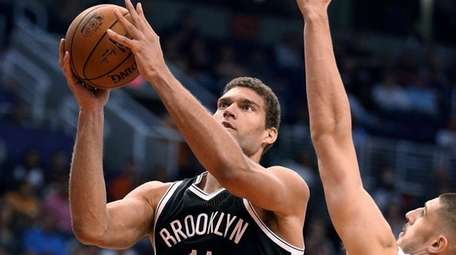 Brooklyn Nets center Brook Lopez goes to the